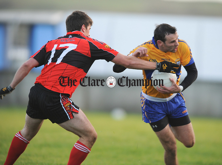 Clare's  Brian Cummins is tackled by UCC's  Barry O Driscoll during their Mc Grath Cup Game at Cooraclare. Photograph by John Kelly.