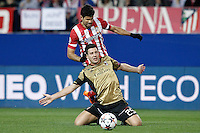 Atletico de Madrid's Diego Costa (t) and AC Milan's Daniele Bonera during Champions League 2013/2014 match.March 11,2014. (ALTERPHOTOS/Acero)