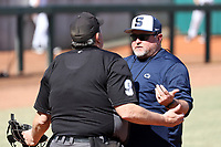 CARY, NC - FEBRUARY 23: Head coach Rob Cooper of Penn State University argues a call with the umpire during a game between Wagner and Penn State at Coleman Field at USA Baseball National Training Complex on February 23, 2020 in Cary, North Carolina.
