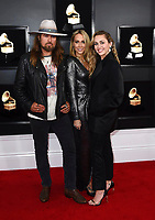 Billy Ray Cyrus, from left, Tish Cyrus, and Miley Cyrus arrive at the 61st annual Grammy Awards at the Staples Center on Sunday, Feb. 10, 2019, in Los Angeles. (Photo by Jordan Strauss/Invision/AP)