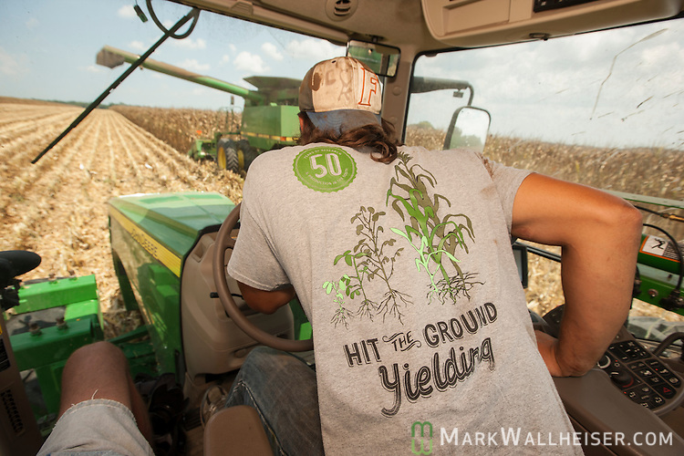 Worker Chevo Vargas follows Randy Dowdy as he harvests his corn crop near Valdosta, Ga August 6, 2014.