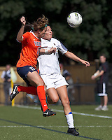University of Virginia forward Kaili Torres (17) and Boston College forward Victoria DiMartino (1) battle for head ball. Boston College defeated University of Virginia, 2-0, at the Newton Soccer Field, on September 18, 2011.