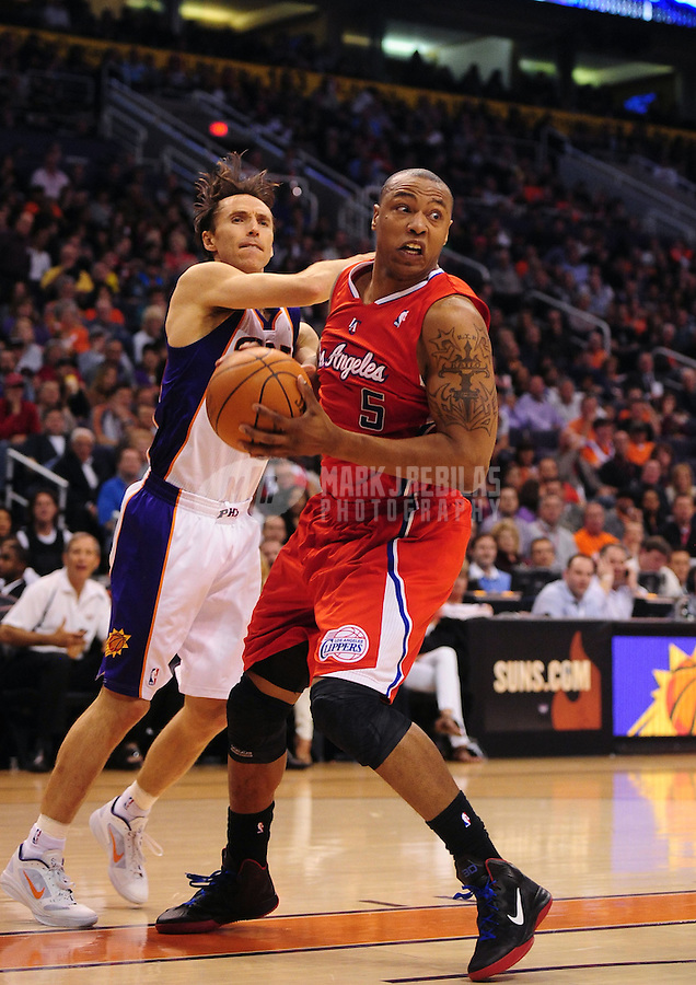 Mar. 2, 2012; Phoenix, AZ, USA; Los Angeles Clippers forward Caron Butler (right) drives to the basket against Phoenix Suns guard Steve Nash at the US Airways Center. The Suns defeated the Clippers 81-78. Mandatory Credit: Mark J. Rebilas-USA TODAY Sports