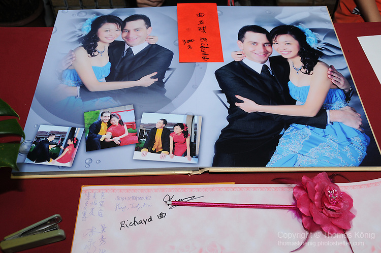 Taiwanese Wedding -- In the evening, the freshly married couple treats the wedding guests to a sumptuous wedding banquet.<br /> <br /> Guests sign in with well-wishes at the reception and give the couple a customary red envelope with money in it.