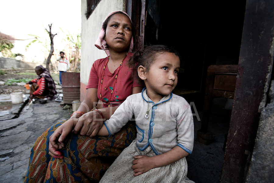 A mother sits with her daughter in a poor neighbourhood of Pokhara, Nepal.