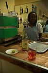 Bar Aquila avec son billard retro et ses anciennes  publicites pour campari et coca cola..Aquila bar with it's vintage billiardo and it's old campari advertisements