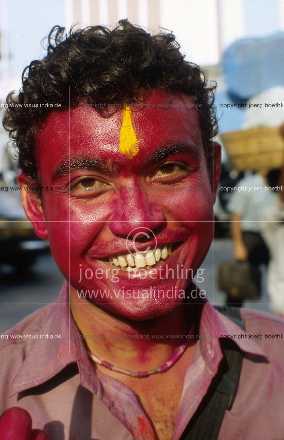 "S?dasien Asien Indien IND Bombay Mumbai .indisches Fruehlingsfest Holi , Menschen bespruehen bespritzen bewerfen sich mit Farbe Farbpuder , junger Mann lachen lachend lustig -  Fest Feste Festival Inder indisch xagndaz | .South Asia India Bombay Mumbai .indian spring festival Holi , people throw color and powder  -  laughing man with colourful red face .| [ copyright (c) Joerg Boethling / agenda , Veroeffentlichung nur gegen Honorar und Belegexemplar an / publication only with royalties and copy to:  agenda PG   Rothestr. 66   Germany D-22765 Hamburg   ph. ++49 40 391 907 14   e-mail: boethling@agenda-fototext.de   www.agenda-fototext.de   Bank: Hamburger Sparkasse  BLZ 200 505 50  Kto. 1281 120 178   IBAN: DE96 2005 0550 1281 1201 78   BIC: ""HASPDEHH"" ,  WEITERE MOTIVE ZU DIESEM THEMA SIND VORHANDEN!! MORE PICTURES ON THIS SUBJECT AVAILABLE!! INDIA PHOTO ARCHIVE: http://www.visualindia.net ] [#0,26,121#]"
