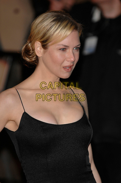 "RENEE ZELLWEGER..""Miss Potter"" World Film Premiere..Empire cinema, Leicester Square..London, England  3rd December 2006 ..portrait black dress..CAP/PL..©Phil Loftus/Capital Pictures"