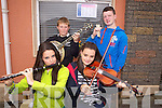 Street busking last Sunday were Abbeyfeale muscians Sarah and Laura O'Donoghue with John Ford and Adrian O'Leary pictured last Sunday in Brosna at the annual Con Curtin music festival.
