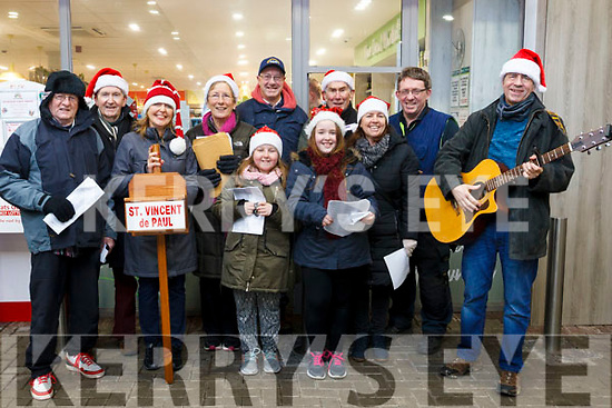 The Curraheen Choir Christmas carol singing in a fundraiser for St Vincent de Paul at O&rsquo;Shea&rsquo;s Garage in Blennerville. <br /> L to r: Pat Duggan, Jack Lacey, Sarah Noonan, Phil Leen, Kevin Boyle, Caitlin O&rsquo;Grady, Christey Browne, Keira Black, Brendan O&rsquo;Brien, Cathy O&rsquo;Grady and Peter Noonan.