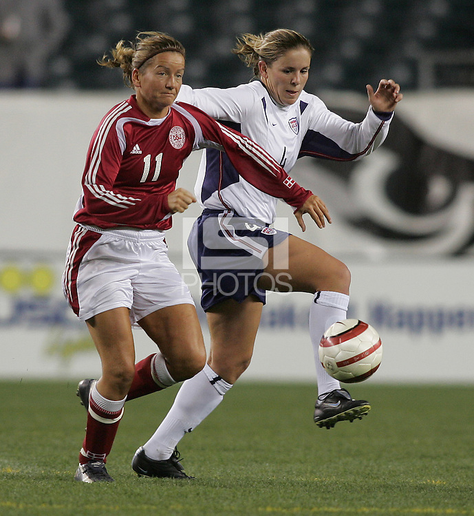 06 November,  2004.  Denmark's Merete Pedersen (11) tries to keep possession of the ball away from Cat Reddick (4) of the USWNT at  Lincoln Financial Field in Philadelphia, Pa.