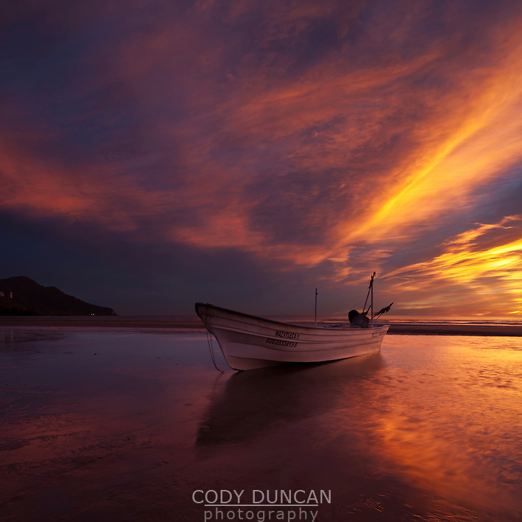 Fishing boat on beach at sunrise, San Felipe, Baja California, Mexico