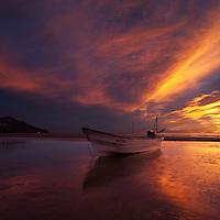 Fishing boat on beach at sunrise, San Felipe, Baja California, Mexico