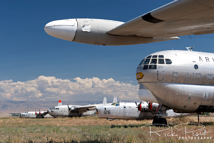 A C-97, a pair of PB4Y's, and a C-119 Flying Boxcar sit in the Hawkins &amp; Powers storage area in Greybull, Wyoming.<br />