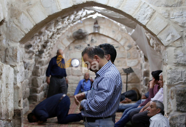 Palestinians pray at the al-Hanbali mosque on the Muslim holy fasting month of Ramadan in the Old City of the West Bank town of Nablus on May 28, 2017. Ramadan is sacred to Muslims because it is during that month that tradition says the Koran was revealed to the Prophet Mohammed. The fast is one of the five main religious obligations under Islam. More than 1.5 billion Muslims around the world will mark the month, during which believers abstain from eating, drinking, smoking and having sex from dawn until sunset. Photo by Ayman Ameen