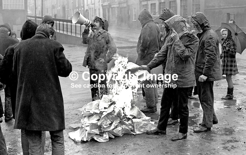 Members of the James Connolly Republican Club, Belfast, N Ireland, burn census forms on the New Lodge Road, Belfast, N Ireland, to protest alleged Ulster Unionist party gerrymanding of parliamentary boundaries. 197104240196b.<br />