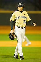 Wake Forest Demon Deacons head coach Tom Walter #32 walks off the field at the end of the first inning against the Northwestern Wildcats at Gene Hooks Field on February 26, 2011 in Winston-Salem, North Carolina.  Photo by Brian Westerholt / Four Seam Images
