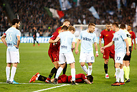 Roma s Diego Perotti, bottom, lies on the pitch after being injured during the Italian Serie A football match between Roma and Lazio at Rome's Olympic stadium, 18 November 2017. Roma won 2-1.<br /> UPDATE IMAGES PRESS/Riccardo De Luca