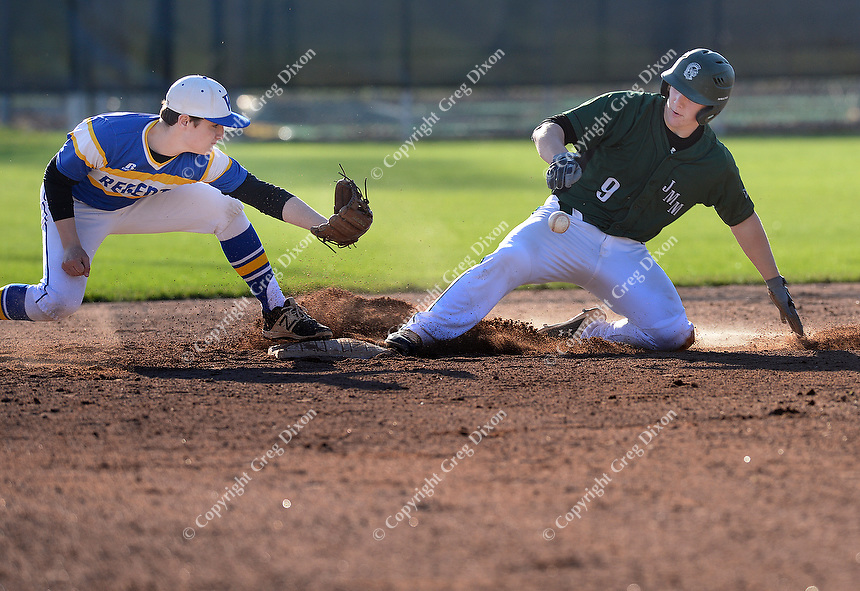 Madison Memorial's Kyle Murphy slides safe into second as a throw goes by Madison West second baseman, Coleman Robbins, as Memorial tops West 2-0 in Big Eight Conference high school baseball on Tuesday, 4/23/19 at Mansfield Stadium field at Memorial High School in Madison, Wisconsin