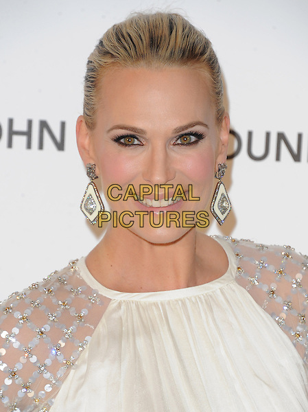 Molly Sims.The 21st Annual Elton John AIDS Foundation Academy Awards Viewing Party held at The City of West Hollywood Park in West Hollywood, California, USA..February 24th, 2013.oscars headshot portrait dangling earrings white sheer sequined .CAP/DVS.©DVS/Capital Pictures.