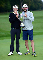 Matthew Fitzpatrick of England poses with the trophy and caddie Tom Ridley following his victory during Round 4 of the 2015 British Masters at the Marquess Course, Woburn, in Bedfordshire, England on 11/10/15.<br /> Picture: Richard Martin-Roberts | Golffile