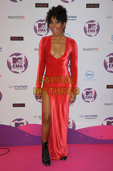 Wynter Gordon.MTV European Music Awards EMA, Odyssey Arena, Belfast, Northern Ireland 6th November 2011.full length red dress plunging neckline cleavage slit split black boots.CAP/PL.©Phil Loftus/Capital Pictures.