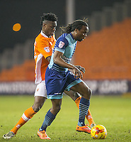 Armand Gnanduillet of Blackpool puts Marcus Bean of Wycombe Wanderers under pressure during the The Checkatrade Trophy match between Blackpool and Wycombe Wanderers at Bloomfield Road, Blackpool, England on 10 January 2017. Photo by Andy Rowland / PRiME Media Images.