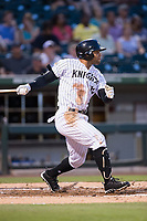 Yoan Moncada (10) of the Charlotte Knights follows through on his swing against the Indianapolis Indians at BB&T BallPark on June 16, 2017 in Charlotte, North Carolina.  The Knights defeated the Indians 12-4.  (Brian Westerholt/Four Seam Images)