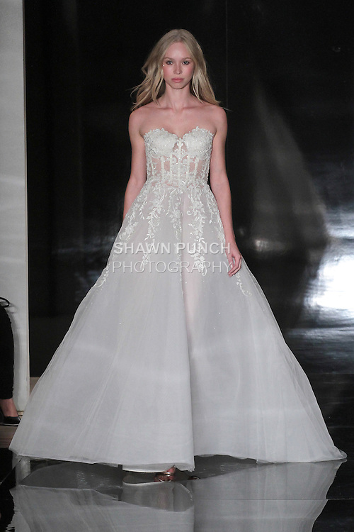 Model walks runway in a strapless embroidered ball gown with corset bodice, from the Reem Acra Spring 2017 bridal collection, during New York Bridal Fashion Week Spring Summer 2017, on April 15, 2016.
