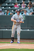 Billy McKinney (20) of the Myrtle Beach Pelicans checks with the third base coach for a sign during the game against the Winston-Salem Dash at BB&T Ballpark on April 18, 2015 in Winston-Salem, North Carolina.  The Pelicans defeated the Dash 4-1 in game one of a double-header.  (Brian Westerholt/Four Seam Images)