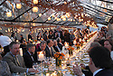 Guests at the Fertel wedding reception enjoy dinner by candle light under a clear tent in Audubon Park, New Orleans, Saturday, March 10, 2007..(Cheryl Gerber for New York Times).. Weddings, New Orleans Photographer