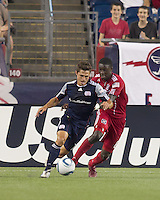 New England Revolution midfielder Ryan Guy (13) dribbles as Chicago Fire defender Jalil Anibaba (6) defends. In a Major League Soccer (MLS) match, the New England Revolution tied the Chicago Fire, 1-1, at Gillette Stadium on June 18, 2011.
