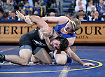 SIOUX FALLS, SD - NOVEMBER 15: Tanner Sloan from South Dakota State controls the arm of Nunzio Crowley from Binghamton during their 197 pound match Friday night at the Sanford Pentagon in Sioux Falls, SD. (Photo by Dave Eggen/Inertia)