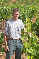 Philippe Michel, Maitre de Chais, cellar master. Domaine du Mas de Daumas Gassac. in Aniane. Languedoc. Vine leaves. France. Europe. Vineyard.