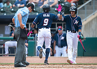 NWA Democrat-Gazette/CHARLIE KAIJO Northwest Arkansas Naturals second baseman Erick Mejia (9) scores during a baseball game, Sunday, May 13, 2018 at Arvest Ballpark in Springdale.