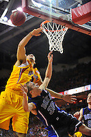Jon Scheyer of the Blue Devils has his shot blocked by Terrapins' Jordan Williams.. Maryland defeated Duke 79-72 at the Comcast Center in College Park, MD on Wednesday, March 3, 2010. Alan P. Santos/DC Sports Box