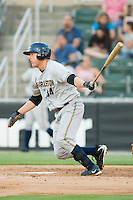 Luke Murton #34 of the Charleston RiverDogs follows through on his swing against the Kannapolis Intimidators at Fieldcrest Cannon Stadium May 29, 2010, in Kannapolis, North Carolina.  Photo by Brian Westerholt / Four Seam Images