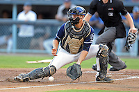 Asheville Tourists catcher Tom Murphy #9 blocks the ball on a play at the plate during a game against the Rome Braves at McCormick Field on July 25, 2013 in Asheville, North Carolina. The Tourists won the game 9-6. (Tony Farlow/Four Seam Images)