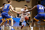 SIOUX FALLS, SD: MARCH 22: D'Ondre Stockman #14 of Fairmont drives between Rollins defenders Sam Philpott #31 and Jeff Merton #44 during the Men's Division II Basketball Championship Game on March 22, 2017 at the Sanford Pentagon in Sioux Falls, SD. (Photo by Dick Carlson/Inertia)