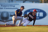 State College Spikes second baseman Michael Massi (16) tags Alex Fernandez (46) sliding into second during a game against the Batavia Muckdogs August 22, 2015 at Dwyer Stadium in Batavia, New York.  State College defeated Batavia 5-3.  (Mike Janes/Four Seam Images)