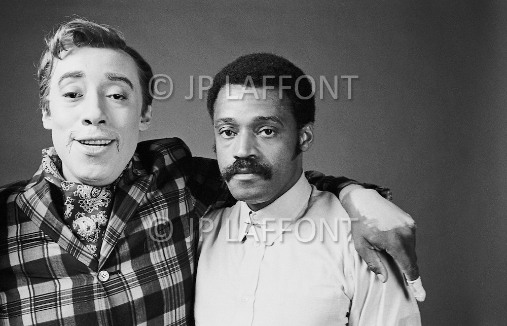 "June 1969 --- Godfrey Cambridge, a black actor, plays a white man turned into a black man, in Melvin Van Peebles' (right) 1970 comedy Watermelon Man. Some of the ""white"" makeup Cambridge is wearing can be clearly seen only partly covering his hand around Van Peebles' shoulder. --- Image by © JP Laffont"