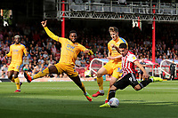 Neal Maupay of Brentford takes a shot at the Wigan goal during Brentford vs Wigan Athletic, Sky Bet EFL Championship Football at Griffin Park on 15th September 2018