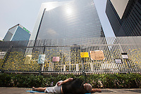 A lone protester sleeps on the ground outside Hong Kong's Central Government Office on day three of the mass civil disobedience campaign Occupy Central, Hong Kong, China, 30 September 2014.