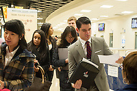 Job seekers attend the Big East Career Fair at Madison Square Garden in New York on Friday, March 15, 2013.  The 16 Big East Conference schools sponsored the event  for students and alumni.  The Department of Labor  announced 10,000 fewer applications for unemployment aid were submitted last week  The average number of weekly applications last month dropped to a five year low. (© Frances M. Roberts)