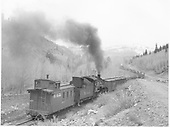 Long caboose #0517 with K-36 helper #484 on rear of freight train.<br /> D&amp;RGW  between Chama &amp; Cumbres Pass, NM  Taken by McMurtry, W. Larry - 5/3/1958
