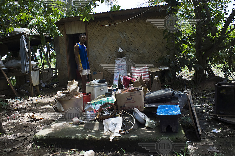 Matereti Sarasau stands outside his home among the debris left by floods that killed eleven people and resulted in eight thousand more being evacuated. The floods devastated much of the Western Division of Viti Levu..