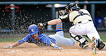 Third baseman Jacob Midkiff (8) of the Presbyterian Blue Hose slides home safely as catcher Carson Wain (4) of the Wofford Terriers applies the tag a fraction late in a game on Wednesday, March 19, 2014, at Fluor Field at the West End in Greenville, South Carolina. (Tom Priddy/Four Seam Images)