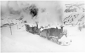 Clearing snow westbound out of Cimarron with 2 flangers and long caboose.<br /> D&amp;RGW  Cimarron, CO  Taken by Perry, Otto C. - 2/22/1940