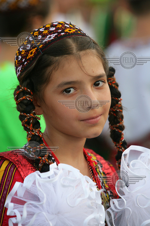 A child at the International Children's Festival organised by the Government of Turkmenistan with delegates from over 20 countries. The Festival promotes the exchange of cultures amongst children from different countries.