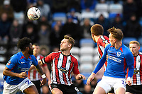 Jake Moult of Altrincham centre vies for the ball with Ellis Harrison of Portsmouth left during Portsmouth vs Altrincham, Emirates FA Cup Football at Fratton Park on 30th November 2019